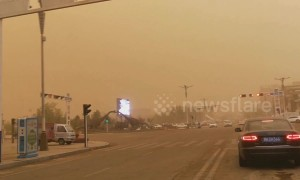 Massive sandstorm turns Chinese city skies dark yellow