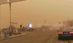 Massive sandstorm turns Chinese city skies dark yellow