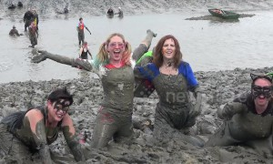 Hundreds of fancy-dress competitors get filthy in the annual Maldon Mud Race