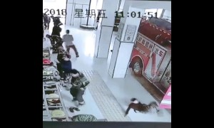 Sliding into danger! Chinese firemen answer emergency call but slip on floor