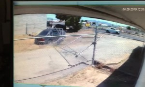 US driver fleeing police smashes through a business' fence to take a shortcut