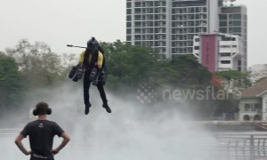 British 'Iron Man' flies jet suit in gridlocked Bangkok claiming it will be the 'future of travel'