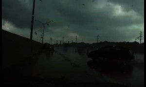 Officer escapes hydroplaning car at the last possible moment