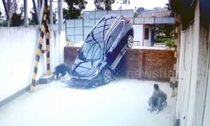 SUV driving off wall narrowly misses worker napping underneath