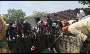 Indian families fetch water from 50-foot well in drought-hit village