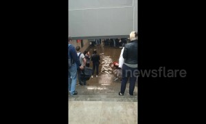 Russian commuters wade through flooded station in Moscow