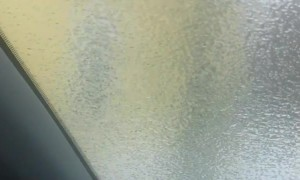 Ice Storm Creates Solid Layer of Ice on Car
