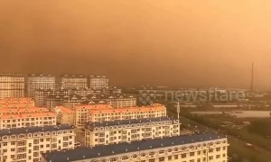 Sky turns orange in Chinese town after cold winds carry dust in air