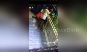 Woman hilariously falls over balcony trying to gather laundry