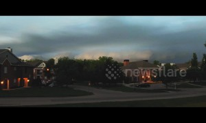 Kansas City suburb shrouded in darkness as storm clouds approach