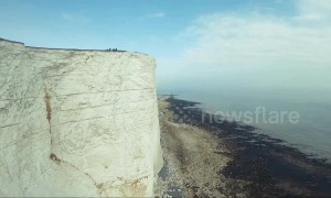 Drone camera spins and rolls in dizzying film of UK cliffside