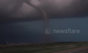 Kansas twister causes semi-truck to flip onto its side