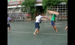 Thai students practice sword fighting during break time