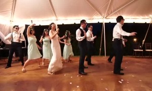 Wedding party joins bride and groom for epic first dance