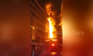 Firefighters on the scene as a mall in China goes up in flames
