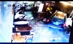 Mother and son escape injury after a car smashes into a restaurant in China