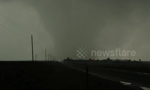 Absolute monster tornado rocks Booker Texas USA as it sweeps across the highway