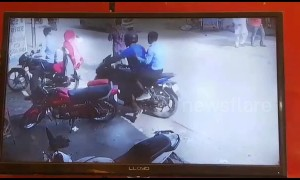 Bag-snatchers in India send woman crashing to ground