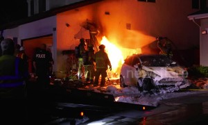 Firefighters tackle blaze after car slams into California home