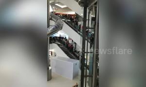 Hundreds of K-Pop fans stampede down escalators to see boyband