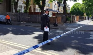 Blood stains the pavement after man fatally stabbed in east London