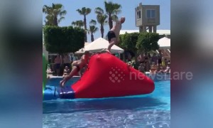 Funny moment UK tourist overtakes Russian in swimming trunks on aquatic assault course