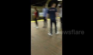 Elderly man starts impromptu session of Tai Chi at Boston train station