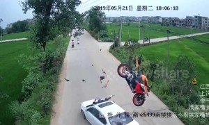 Motorcycle flips through the air after head-on car crash, throwing rider onto bonnet