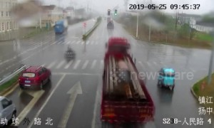 Chinese moped rider slides out of path of oncoming lorry in amazing near-miss