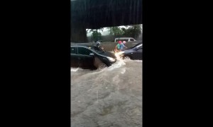 Motorists drive through heavy flash floods in the Philippines