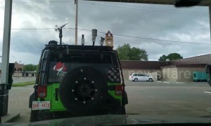Tornado sirens wail as a storm chasers prepare in Beloit Kansas, USA