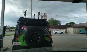 Tornado sirens wail as a storm chasers prepare in Beloit Kansas, USA
