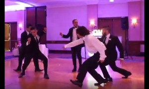 Groomsmen pull off surprise wedding dance for newlyweds