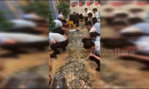 Chinese businessman uses 16 buckets of coins to pay for property