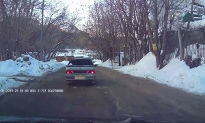 Man Races After Reversing Car in Russia