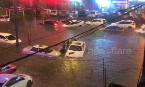 Vehicles submerged in deep water after heavy rainstorm causes floods in China