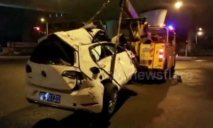 Car falls off 30-foot-high overpass after dramatic crash in Shanghai