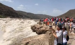 Spectacular Hukou Waterfall on Yellow River in full flow after rainfalls