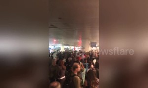 Hundreds of passengers wait after power outage causes evacuation of LAX airport
