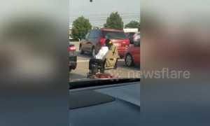 Man captures woman on mobility scooter waiting for turn signal on US road