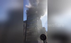 Huge clouds of smoke rise from building fire in Mayfair, London