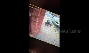 CCTV footage captures horrifying moment UK courier stumbles into bus after falling off bike