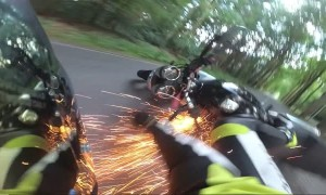 Sparks Fly From Intense Motorcycle Wreck
