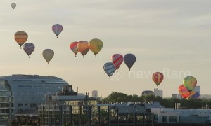 Fleet of hot air balloons rise above London for charity event