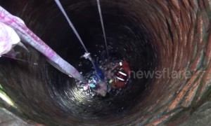 Chinese girl clings onto bed sheets for 15 minutes after falling down a well