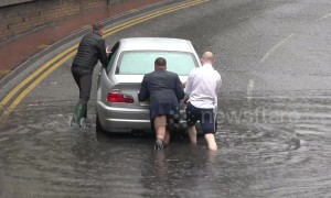 Kind men help stranded motorist during flooding in West London