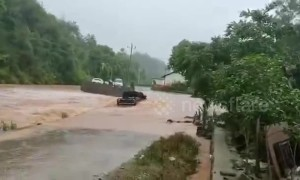 Flash floods sweep away car after driver tried to force their way through submerged road in China
