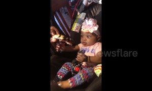 Cute hungry baby excited to try her first rib