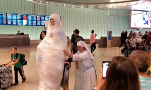 Virgin Mary wheeled around LAX