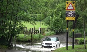 UK drivers cross flooded road in Birmingham despite warnings